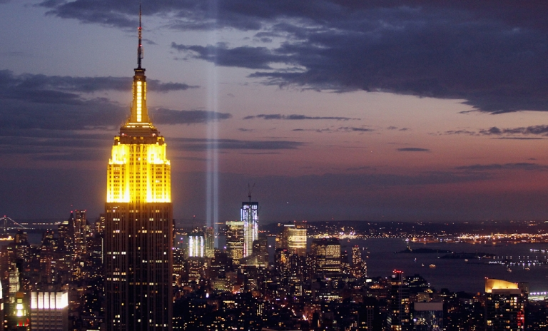 <p>The Tribute in Light is seen behind the Empire State Building on September 10, 2011 in New York City. The Tribute in Light is an art installation honoring those who perished in the 9/11 attacks.</p>