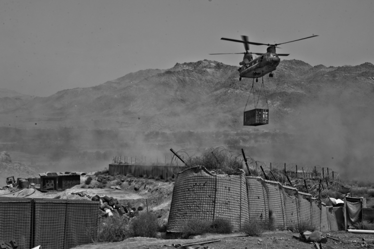 <p>A CH-47 Chinook arrives at Combat Outpost Baylough with a trailer full of supplies for the remote base.</p>