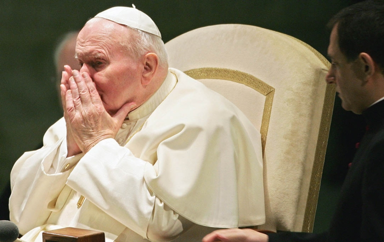 <p>Pope John Paul II sneezes during his weekly general audience at the Vatican in 2005.</p>