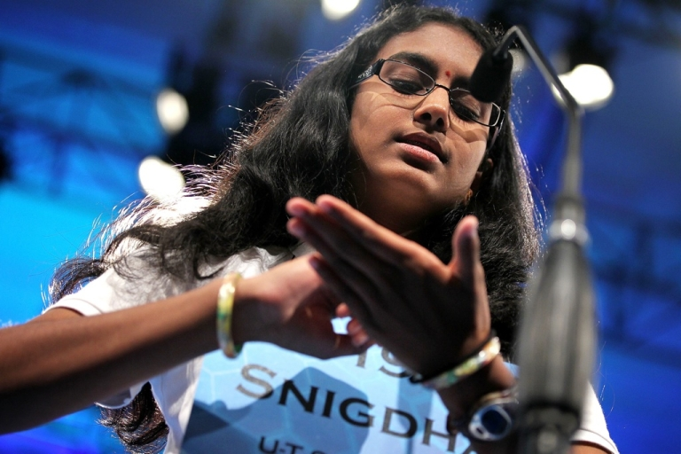<p>Spelling Bee contestant Snigdha Nandipati of San Diego, Calif., tries to spell her word during the round 4 of the Scripps National Spelling Bee in National Harbor, Md., on May 31, 2012.</p>