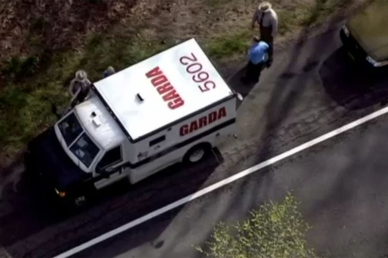 <p>Armored-car officers speak to state troopers today near Washington after the truck lost more than $5,000.</p>