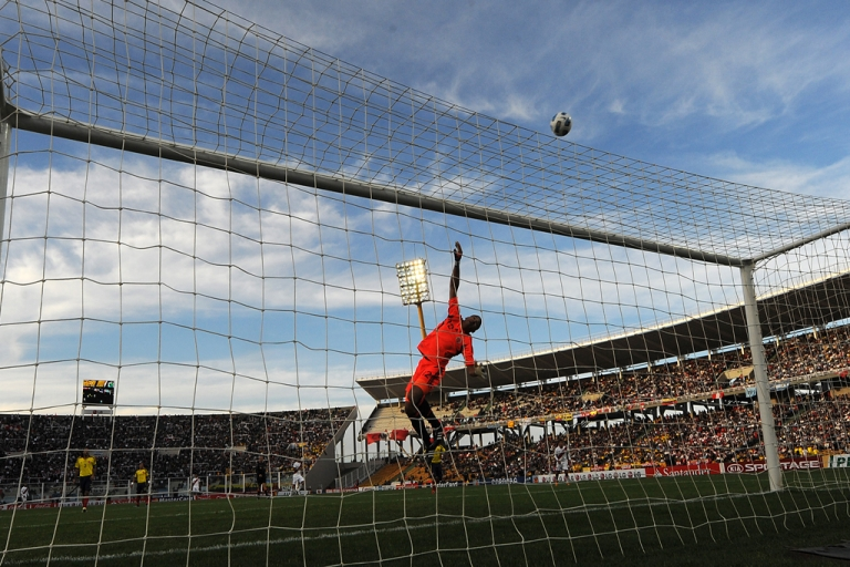 <p>Colombian goalkeeper Luis Martinez jumps to clear a ball during the 2011 Copa America quarter-final football match against Peru, at the Mario Kempes stadium in Cordoba, 770 Km northwest of Buenos Aires, on July 16, 2011.</p>