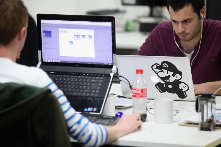<p>People work at computers in TechHub, an office space for start-up entrepreneurs, near the Old Street roundabout in Shoreditch which has been dubbed 'Silicon Roundabout' due to the number of technology companies operating from the area on March 15, 2011 in London, England.</p>