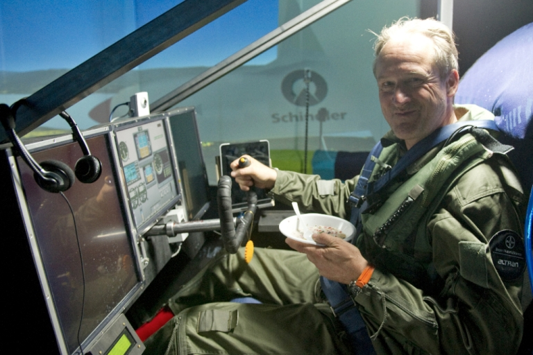 <p>Swiss businessman and pilot Andre Borschberg eats as he takes part in a non-stop 72 hour flight simulation on a Solar Impulse plane simulator, at a military base hangar in Dubendorf, on February 24, 2012. Borschberg's successful flight simulation is one step further towards an around the world flight with the experimental solar powered Solar Impulse aircraft, which is planned for 2014.</p>