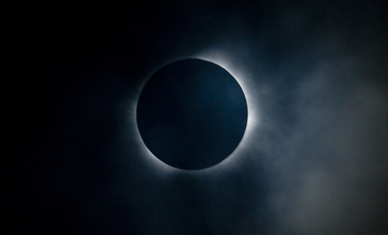 <p>The sun is seen partially covered by the moon on Easter Island, 3700 km off the Chilean coast in the Pacific Ocean, on July 11, 2010.</p>