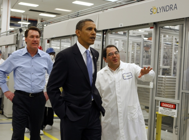 <p>Ben Bierman (R) and Chris Gronet (L) lead U.S. President Barack Obama on a tour of the Solyndra solar panel company May 26, 2010, in Fremont, California. The company declared bankruptcy in August.</p>