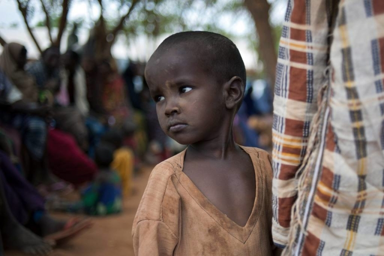 <p>A Somali boy waits for registration into Ifo refugee camp, which is part of the larger Dadaab camp located in Kenya. He joins thousands of other displaced drought victims who wait as long as ten days before becoming fully registered at the camp.</p>