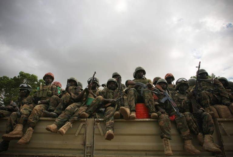 <p>A truck transports soldiers from the African Union Mission in Somalia.</p>