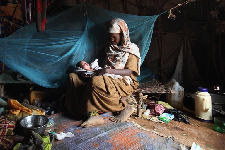 <p>Somalian refugee Baar Abdi Khalif rests in her homemade shelter with her 20-day-old baby on the edge of the giant Dadaab refugee settlement on July 23, 2011 in Dadaab, Kenya. The ongoing civil war in Somalia and the worst drought to affect the Horn of Africa in six decades has resulted in an estimated 12 million people whose lives are threatened.</p>
