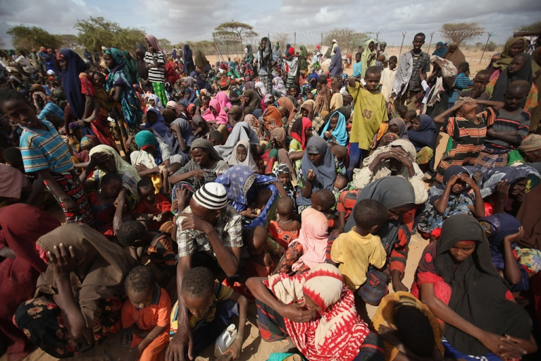 <p>Somalian refugees wait in the registration area of the Dagahaley refugee camp which makes up part of the giant Dadaab refugee settlement on July 23, 2011 in Dadaab, Kenya.</p>