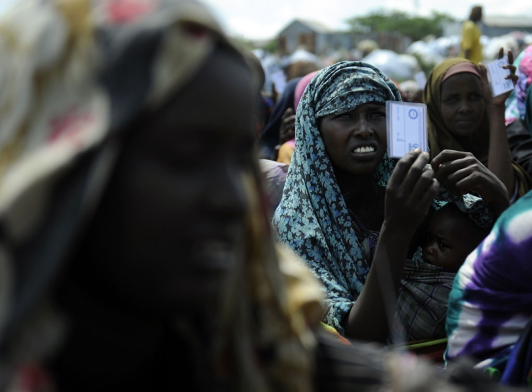 <p>Women displaced from southern Somalia by famine sit in a camp for internally displaced people in Mogadishu waiting for aid supplies. The UN on Feb. 3, 2012, said that famine conditions have ended in Somalia, six months after first being declared.</p>