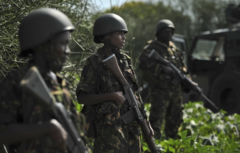 <p>Kenyan Defense Force soldiers are pictured in Ras Kamboni, southern Somalia on December 13, 2011.</p>