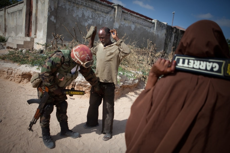 <p>Civilians are searched thoroughly before entering the AMISOM-run local hospital. Security remains tight throughout the city.</p>