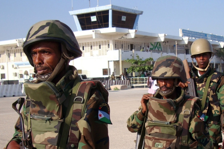 <p>A British man was arrested at Mogadishu airport after saying that he intended to travel to Kismayo. These African Union soldiers did not arrest the man, but are shown with Mogadishu's Adan Ade international airport on December 20, 2011.</p>