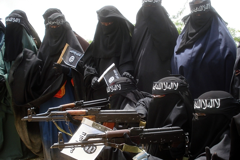 <p>American Omar Hammami, known as Al Amriki, is fighting in Somalia with the radical Islamic group, Al Shabaab. Here Somali women in a demonstration by Al Shabaab rebels on July 5, 2010. The demonstrators were carrying placards written with slogans against the African Union peacekeeping force.</p>