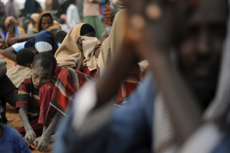<p>Aid agencies like Oxfam and Save the Children have tried to explain why they have moved slowly in response to famine in the Horn of Africa. Here, a dusty-faced young Somali boy waits with other Somali refugees lining-up at a registration centre on August 2, 2011 at Dagahaley refugee site within the Dadaab complex to be registered to receive aid after having been displaced from their homes in southern Somalia by a famine that is ravaging the horn of Africa region.</p>