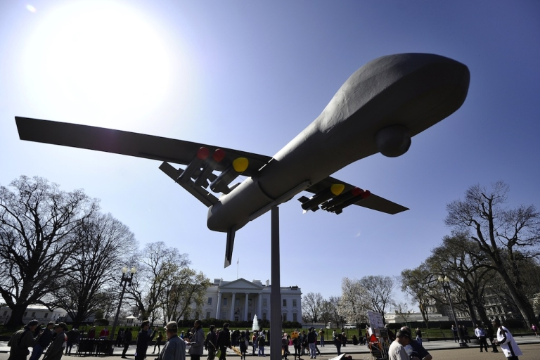 <p>Anti-war protesters displays an effigy of an attack drone as they take part in a demonstration in front of the White House in Washington, DC, on Mar. 19, 2011.</p>