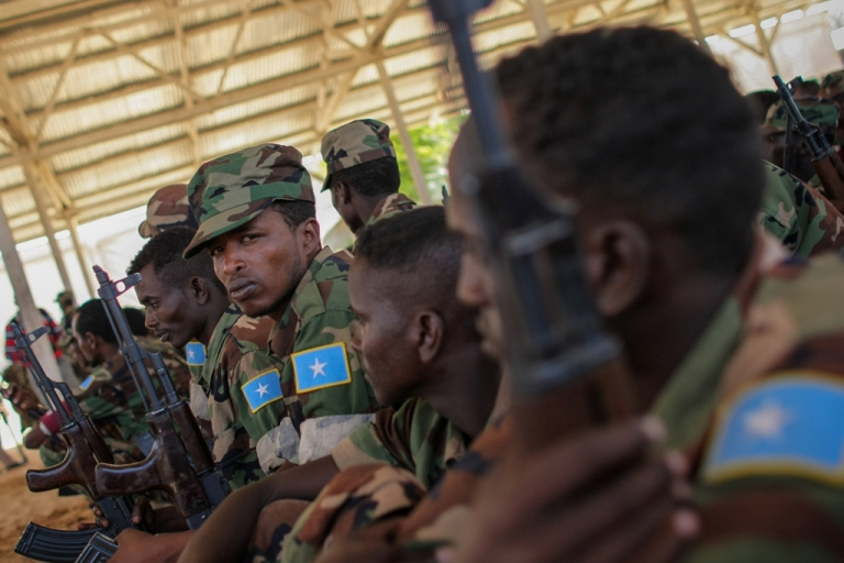 <p>Recently trained members of the Somali National Army (SNA) sitingt during a passing-out parade at an African Union Mission in Somalia (AMISOM) training facility on the western fringes of Mogadishu. The SNA has helped liberate large areas and towns of strategic importance across Somalia from the Al-Qaeda-affiliated terrorist group Al Shabaab.</p>