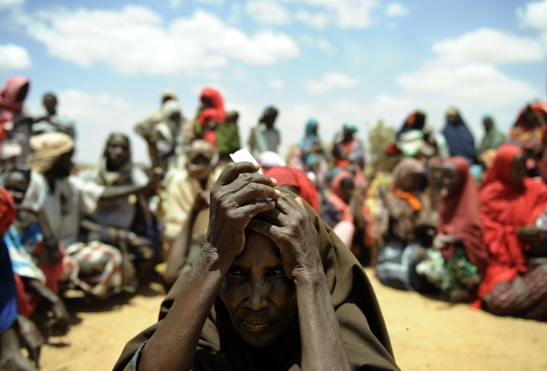 <p>A newly arrived elderly Somali woman waits with others new arrivals to be registered as refugees in Doolow, south western Somalia. Doolow is the main exit point for Somalis from Bay, Bakool and Gedo regions fleeing to Ethiopia to escape war and a severe drought currently ravaging the country, with the UN declaring famine in six Somali regions.</p>