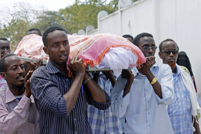 <p>Somali people carry the body of journalist Abdisatar Dahir who was killed in a double suicide attack in a restaurant in Mogadishu. According to the International Press Institute, 16 journalists have been killed this year in Somalia, 119 total worldwide, the highest number since the 1990s.</p>
