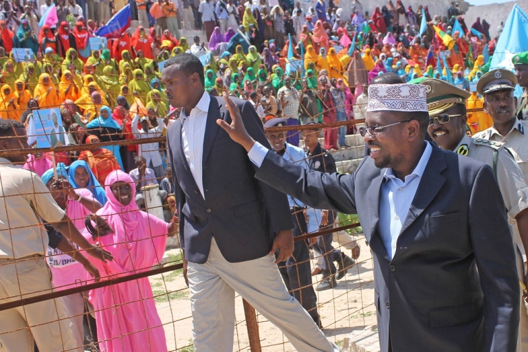 <p>The president of Somalia Sheikh Sharif Ahmed waves to hundreds of Mogadishu residents at a ceremony marking the first anniversary of terror group Al-Shabab's withdrawal from Mogadishu at Konis Stadium in north of the capital on August 6, 2012. In a field of dozens of candidates, Ahmed is confident of re-election later this month.</p>