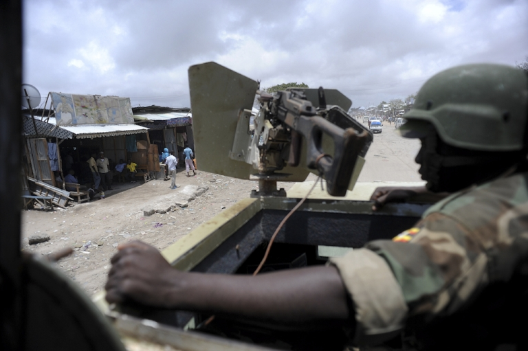 <p>African Union peacekeepers patrol the outskirts of Mogadishu on September 12, 2012.</p>