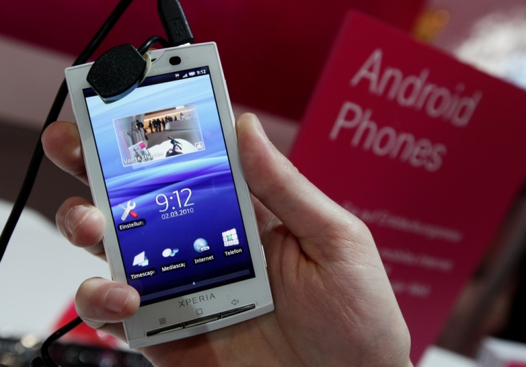<p>A stand host holds a Sony Ericsson XPERIA X10 mobile phone that uses the Android operating system at the Deutsche Telekom stand at the CeBIT Technology Fair on March 2, 2010 in Hannover, Germany.</p>