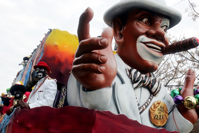 <p>People dressed in blackface rode a float during the Zulu parade, a primarily African-American parade, during Mardi Gras festivities  in New Orleans, Louisiana, on Feb. 8, 2005.</p>