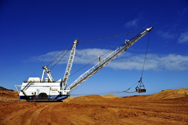 <p>Earth moving equipment at a former diamond mine in Kleinzee, South Africa.</p>