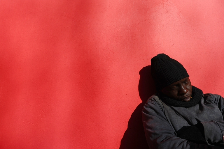 <p>A South African man sleeps on a main street in Johannesburg, on June 15, 2010.</p>