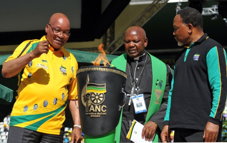 <p>That's how they roll. Here, South Africa President Jacob Zuma (L) and South Africa's Deputy President Kgalema Motlanthe (R) look at the centenary flame during celebrations of the centenary of Africa's oldest liberation movement, South Africa's ruling ANC, in Bloemfontein on Jan. 8, 2012.</p>