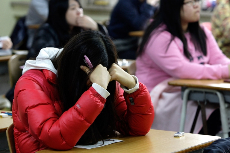 <p>South Korean students take their College Scholastic Ability Test at a school on Nov. 18, 2010 in Seoul. Traditional textbooks may soon be a thing of the past in South Korea. The education ministry has announced that it will invest $2.4 billion toward ensuring that all schools use digital textbooks by 2015.</p>