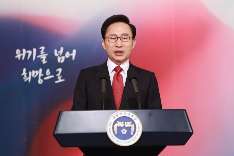 <p>South Korean President Lee Myung Bak makes a televised New Year speech in Seoul on Jan. 2, 2012. Lee said the door for better cross-border ties is left open this year as North Korea's new leader takes over while vowing to respond strongly to any provocations.</p>