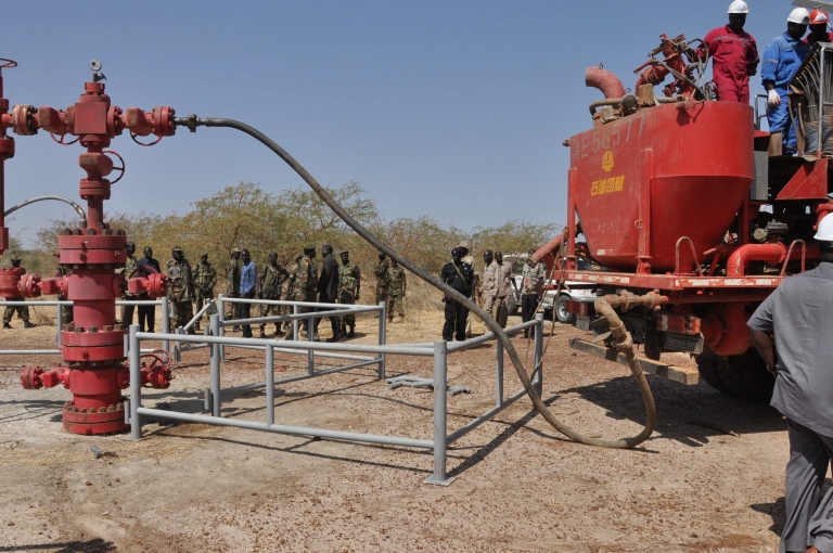 <p>Workers at the Petrodar oil concession flush out remaining oil prior to a shutdown on oil production by South Sudan on January 29. The new nation has accused its neighbor Sudan of 'stealing' southern crude that runs through a pipeline to a northern port, sparking tensions between the two countries.</p>
