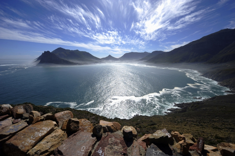 <p>A general view of the Hout Bay harbour covered in mist is seen on May 8, 2010 from the Chapman's peak road on the outskirts of Cape Town. Chapman's peak road is the coastal link between Cape Town and the Cape of Good Hope. When following the African coastline from the equator the Cape of Good Hope marks the psychologically important point where one begins to travel more eastward than southward, thus the first rounding of the cape in 1488 by Portuguese explorer Bartolomeu Dias was a major milestone in the attempts by the Portuguese to establish direct trade relations with the Far East. He called the cape Cabo Tormentoso. As one of the great capes of the South Atlantic Ocean, the Cape of Good Hope has been of special significance to sailors for many years and is widely referred to by them simply as 'the Cape'. It is a major milestone on the clipper route followed by clipper ships to the Far East and Australia, and still followed by several offshore yacht races.</p>