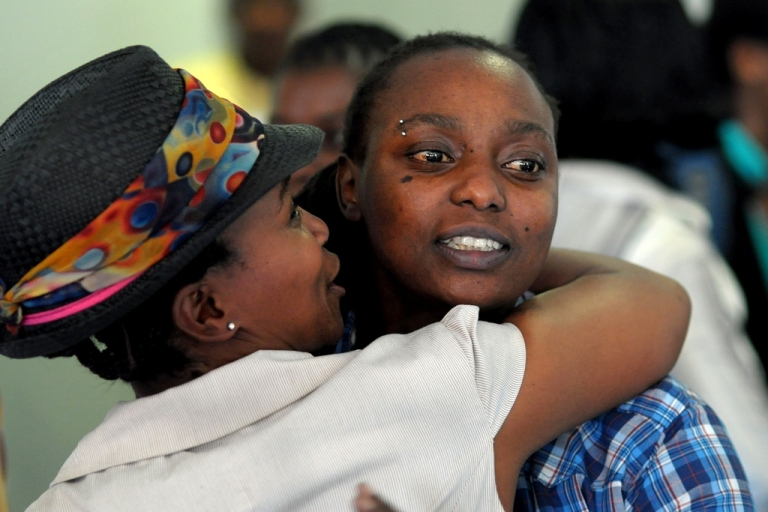 <p>Two delegates greet one another a conference on sexual orientation, gender identity and human rights in Africa, on November 15, 2010 in Cape Town, South Africa. The conference is charged to analyse the challenges faced by the lesbian, gay, bisexual and intersex communities in Africa.</p>