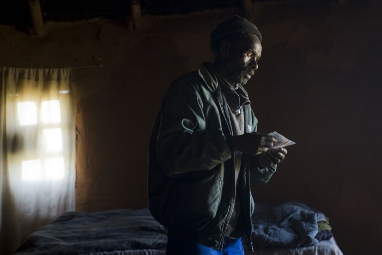 <p>Former South African miner Vuyisile Gibson stands on November 8, 2011 in his mud hut near the town of Tsolo in the Eastern Cape province. He is undergoing tests to see whether his poor health is due to decades of breathing dust while working in Anglo American gold mines. Silicosis is caused by inhaling gold mining dust and can rest dormant for years before permanently scarring the lungs.</p>
