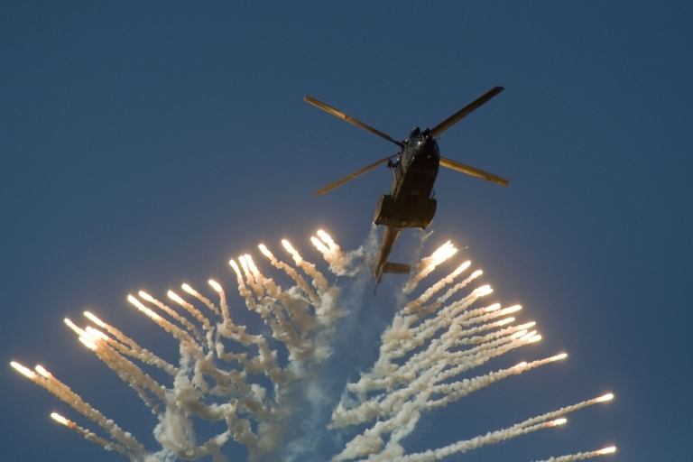 <p>A lawsuit alleges that the South African MTN cell phone company promised to deliver South African military helicopters to Iran in exchange for a lucrative contract to operate a cell phone network in Iran. Here a South African Air Force helicopter fires flares during the Africa Aeronautics and Defence (AAD) Airshow, on September 24, 2010, in Cape Town.</p>