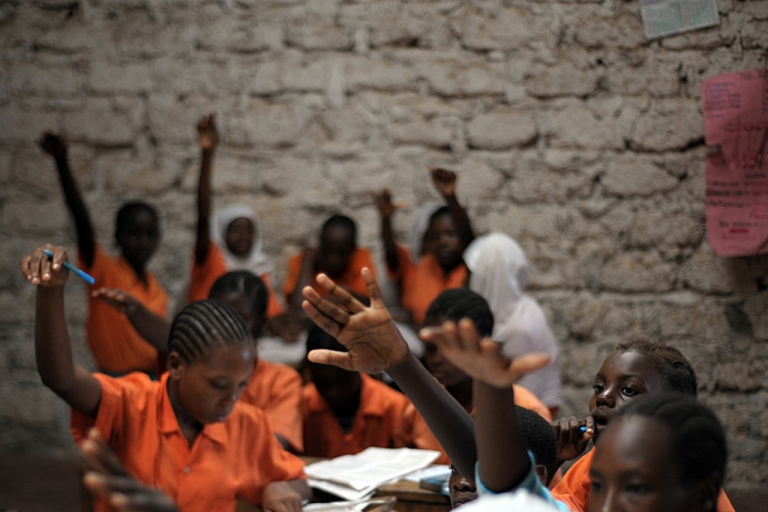 <p>Schoolgirls participate in a lesson in Kilifi, approximately 50 kilomtres north-east of Mombasa on June 23, 2010.</p>
