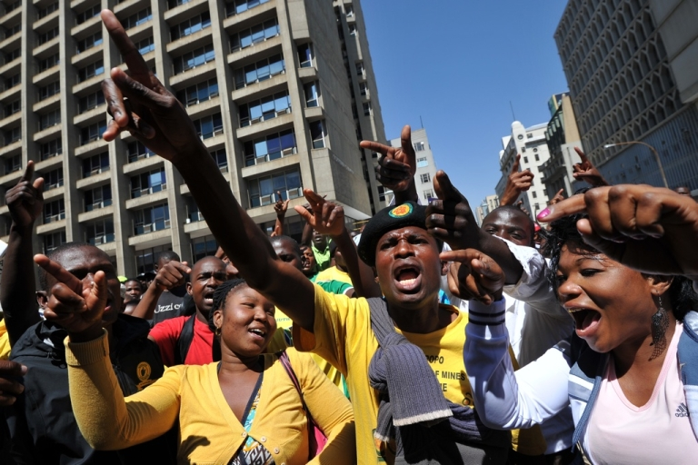 <p>Supporters of African National Congress (ANC) Youth League leader Julius Malema sing outside the court in Johannesburg on September 12, 2011 that found Malema guilty guilty of hate speech for singing an anti-apartheid anthem whose lyrics mean 'shoot the white farmer.' After the verdict, some Malema supporters began singing it outside the court, in open defiance of the court order. No action was taken against them.</p>
