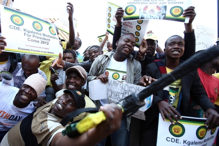 <p>Supporters of the African National Congress (ANC) youth leader Julius Malema demonstrate for him on September 2, 2011 outside the ANC Luthuli house in Johannesburg during his disciplinary hearing. Hundreds of Malema supporters threw stones and bottles at police while burning the ruling party's flag and T-shirts bearing the face of President Jacob Zuma on August 30, 2011. Malema could be expelled from the ANC at the closed-door hearing.</p>