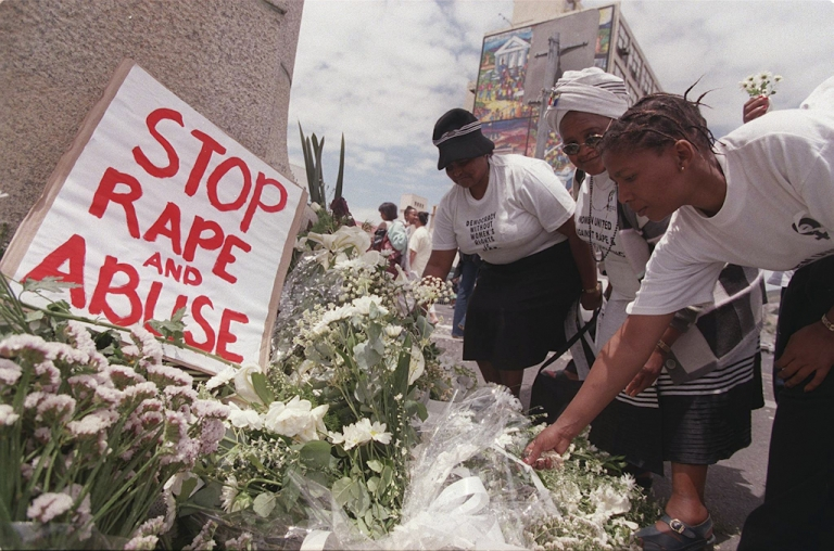 <p>Women place white flowers outside parliament during a demonstration in Cape Town on the International Day for the Prevention of Violence against Women. South Africa has one of the highest rates of rape in the world.</p>