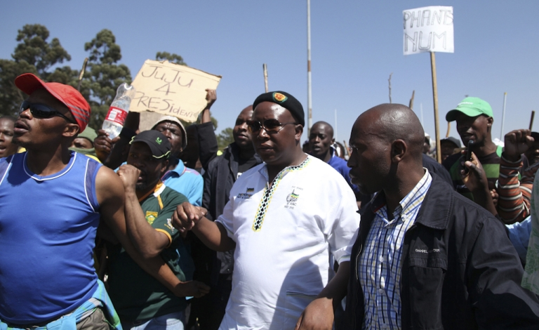 <p>The former leader of the South African ruling party's youth league, Julius Malema (C), arrives on September 11, 2012 at the Gold Fields Driefontein mine in Carletonville, west of Johannesburg, South Africa. Malema on September 11 called on mine workers to strike for five days each month until mining giants bow to a 12,500 rand ($1,500) basic salary demand. Malema, who was expelled early this year from the ruling African National Congress (ANC) for ill-discipline, told around 3,000 workers at a stadium in the gold mining town where 15,000 Gold Fields miners downed tools on Sepetember 9 that if demands were not met to strike for five days each month.</p>