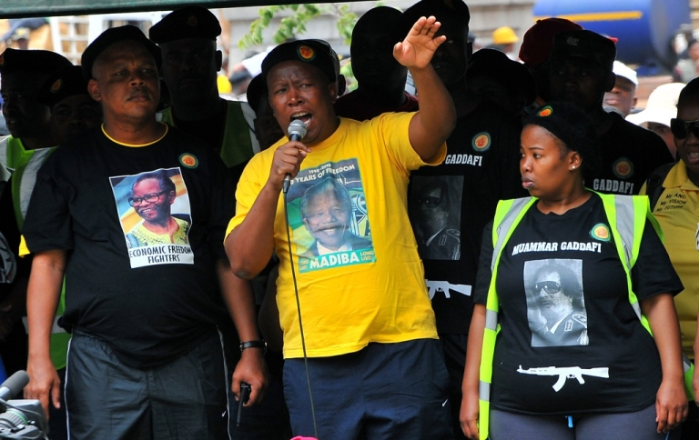 <p>The youth wing of the ruling African National Congress (ANC) leader Julius Malema addresses militants on October 27, 2011, during a demonstration in downtown Johannesburg. He was suspended from the party in November 2011.</p>