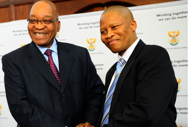 <p>South African President Jacob Zuma congratulates his new Chief Justice Mogoeng Mogoeng in Pretoria on September 8, 2011.</p>