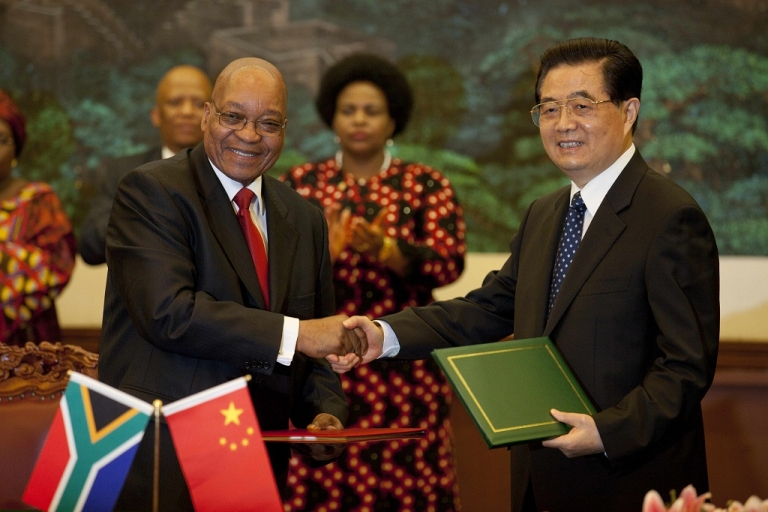 <p>South African President Jacob Zuma (R) looks over at Chinese President Hu Jintao (2nd L) during the meeting between their delegations in Beijing on August 24, 2010. Some economists speculate that the South African government is looking to China as a possible economic role model.</p>