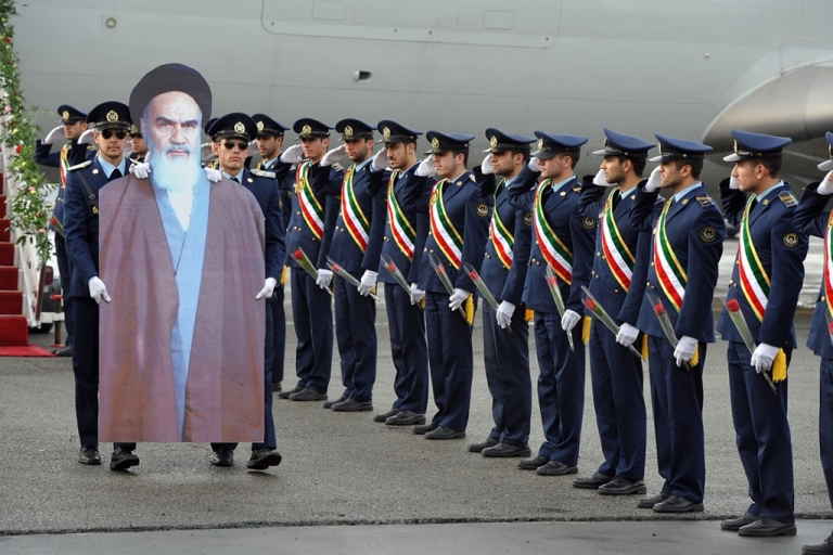 <p>Iranian air force soldiers carry a cardboard cut out of late founder of Islamic Republic Ayatollah Ruhollah Khomeini. The threat of an Iran war looms large for the often overlooked nations of the South Caucasus.</p>