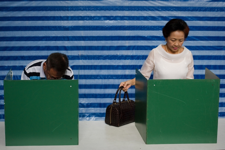 <p>Thai people cast their vote at the Sawadee school in Bangkok on July 3, 2011.  Thailand voted in a hard-fought election pivotal to the future of the divided kingdom after years of political turmoil pitting the ruling elite against the disaffected rural poor.</p>