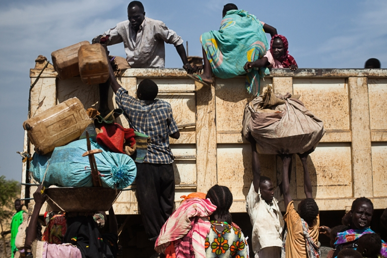 <p>Nubans pile onto the back of a truck heading towards Yida refugee camp in South Sudan. The numbers of Sudanese  arriving at Yida is dramtically increasing each week, according to medics working at the camp.</p>