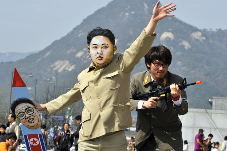 <p>A South Korean activist (C) wearing a mask of North Korean leader Kim Jong Un holds a mock missile during a rally denouncing North Korea's rocket launch and the three-generational dictatorship, in Seoul on April 15, 2012. Has normal electoral rules applied, tensions with the North, plus renewed concern over Pyongyang's missile and nuclear programs, would normally have benefited the opposition. But as signs of an opening up emerge under the North Korea's new leader Kim Jong Un, the appetite south of the border could be for a leader more willing to re-open the door to aid and dialog.</p>